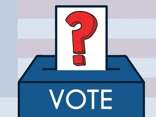 """A piece of paper with a large red question mark on it is inserted into a box that says """"Vote"""" on it."""