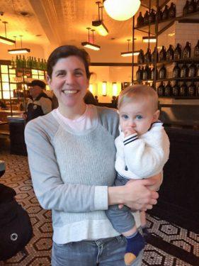 Photo of Jacqueline Chmielnicki holding a baby.