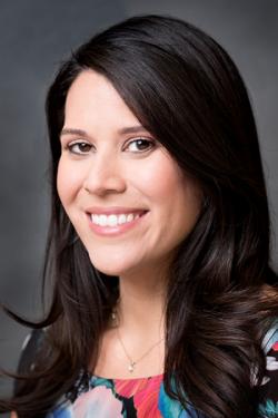 Headshot of Andrea Valdez.