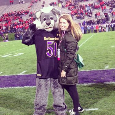 Photo of Brenna Otierney with Willy the Wildcat, Northwestern's mascot.