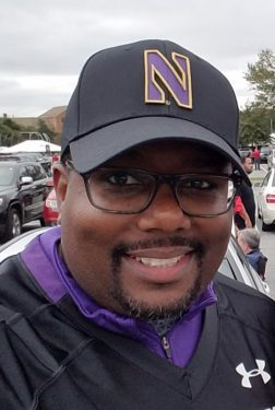 Elliot Smith wearing a Northwestern baseball hat.