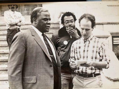 Black and White photo of Jonathan Eig interviewing Harold Washington.