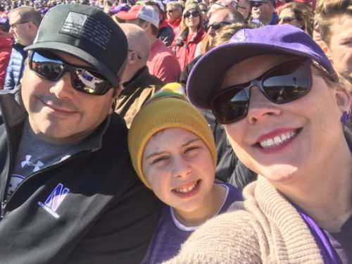 Kelly Brockmeier with husband and son at a football game at Ryan Field.