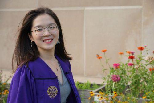 Headshot of Celine Zhang in purple regalia.