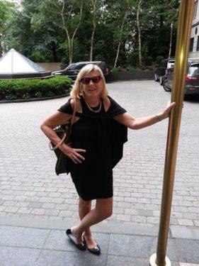 Nancy Wishmeier standing in front of a brick road.