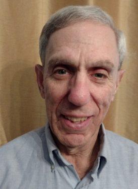 Headshot of James Gutman.
